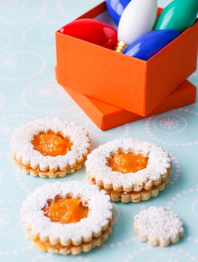 Linzer Cookies with Homemade Orange Marmalade are the perfect holiday cookies! You'll love these Linzer cookies with homemade orange marmalade -- they're delicious and pretty!