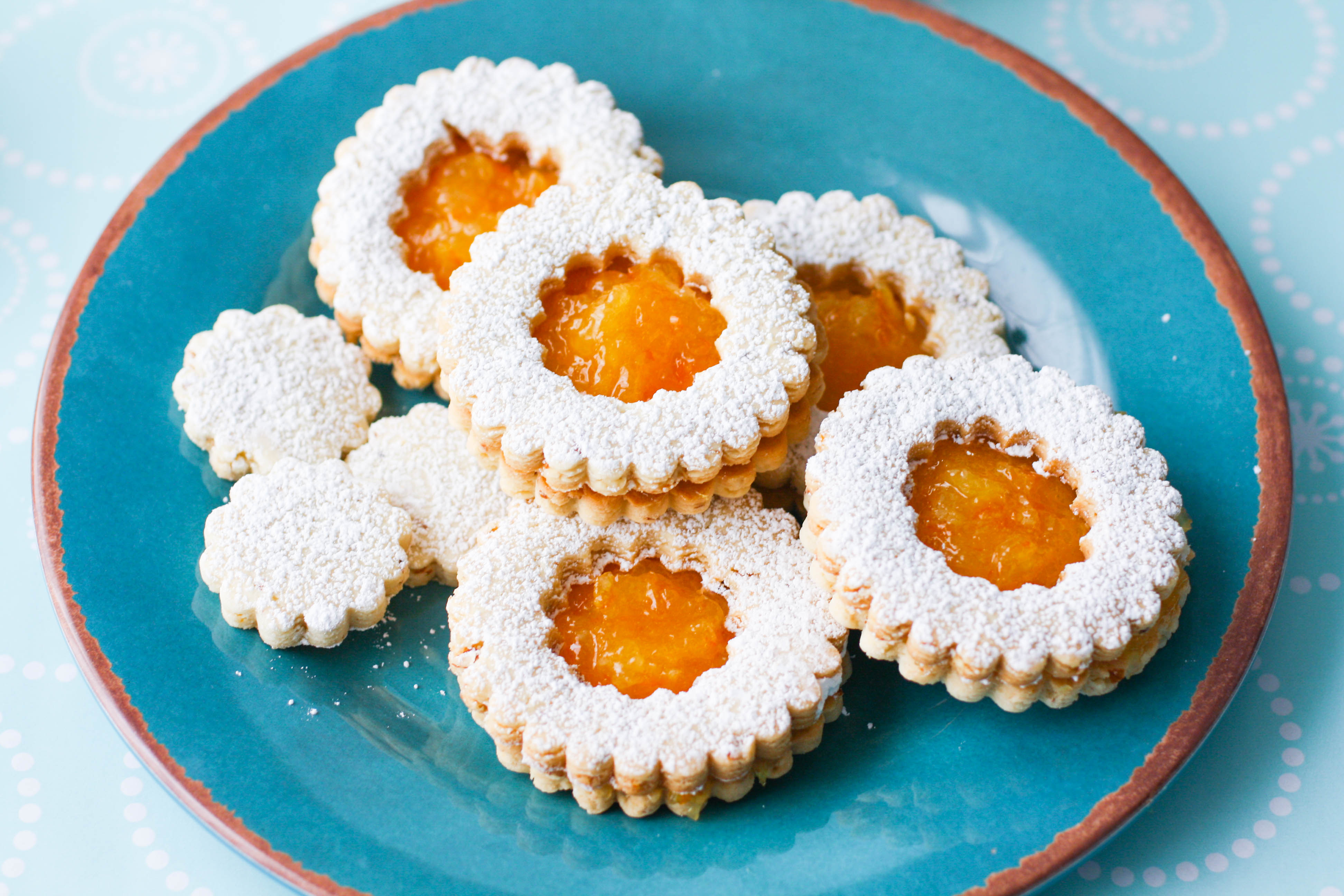 Linzer Cookies with Homemade Orange Marmalade are quite a treat for the season. You'll enjoy making and eating these lovely linzer cookies!
