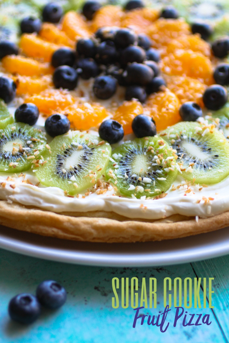 Sugar Cookie Dessert Pizza will be the perfect treat for summertime parties! Sugar Cookie Dessert Pizza is easy to make and so tasty for an easy, pretty dessert!