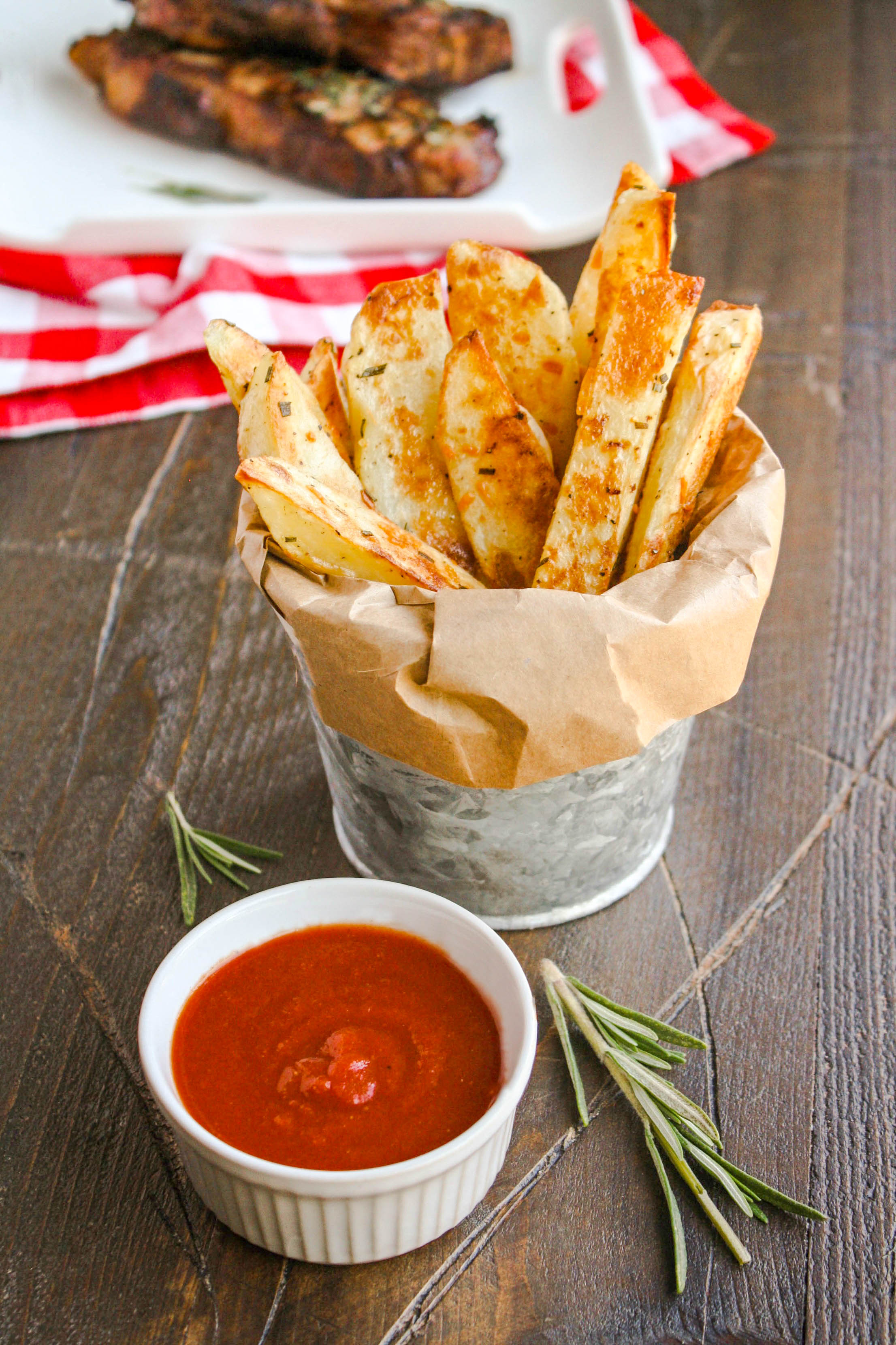 Oven Baked Rosemary Steak Fries Homemade Ketchup make a great side dish. You'll love their crispiness.