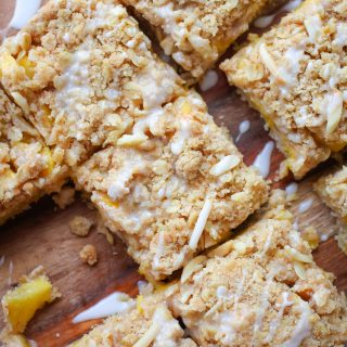 Peach Crumble Squares with Bourbon Glaze are lovely summertime treats. You'll love these Peach Crumble Squares with Bourbon Glaze for your next dessert idea.
