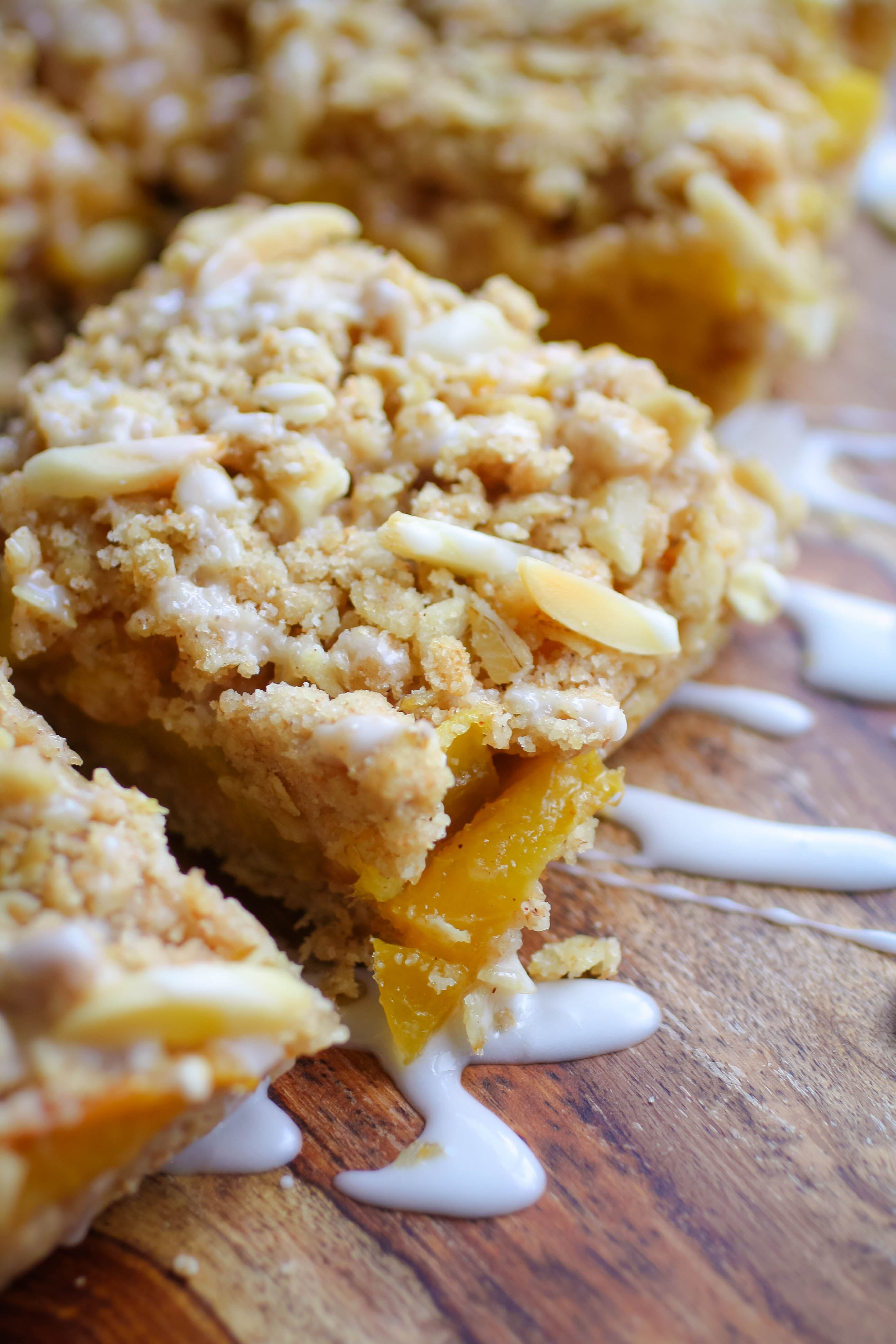 Peach Crumble Squares with Bourbon Glaze for the sweet-treat win! You'll enjoy these Peach Crumble Squares with Bourbon Glaze this season!
