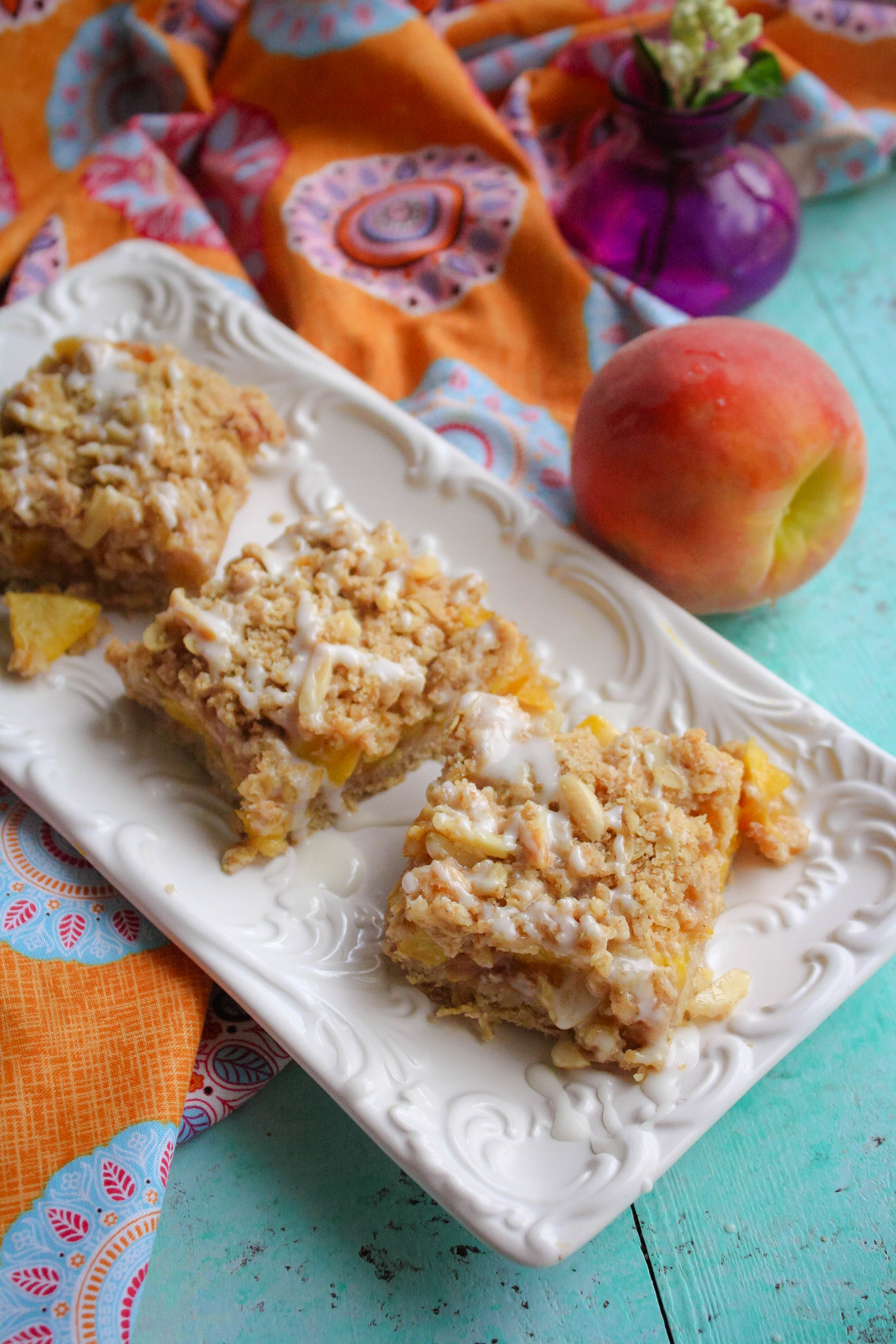 Peach Crumble Squares with Bourbon Glaze make a luscious sweet treat this season. Peach Crumble Squares with Bourbon Glaze are special summertime treats, for sure!