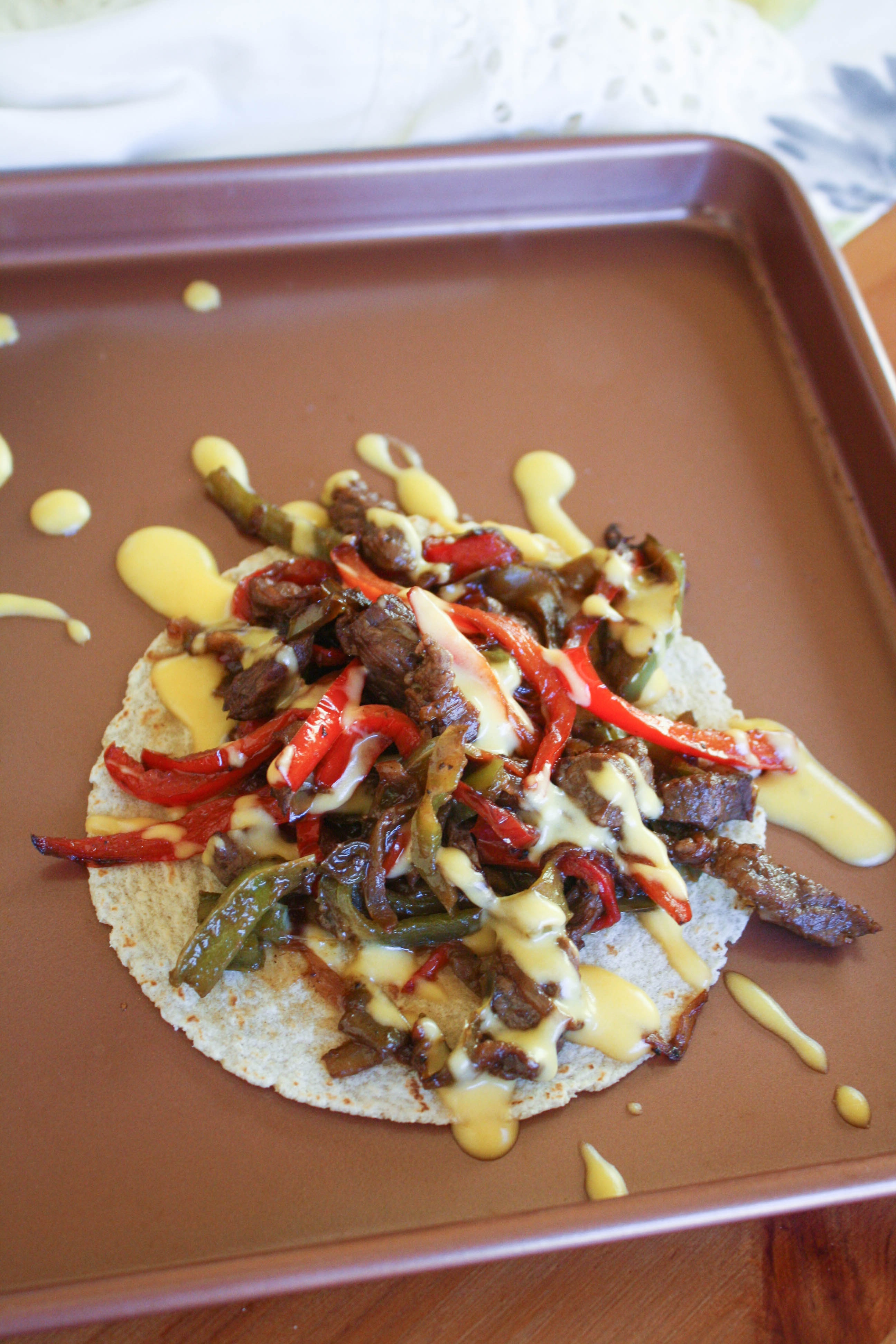 Philly Cheesesteak Tostadas are a fun mealtime dish! Philly Cheesesteak Tostadas are fun and easy to put together.