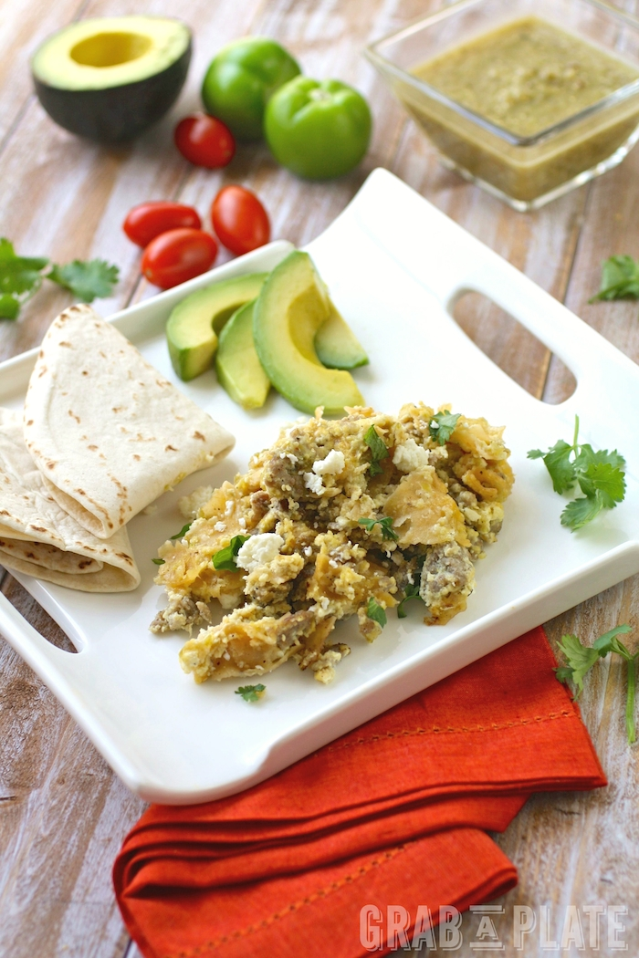 A plate of Skillet Pork Migas with Roasted Tomatillo Salsa is the perfect breakfast dish!
