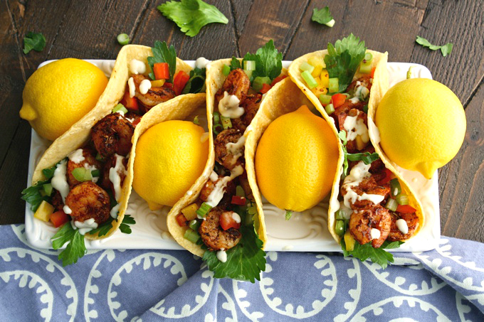 Ready to celebrate...anything? These Blackened Shrimp Tacos & Creamy Garlic-Lemon Sauce will do the trick!