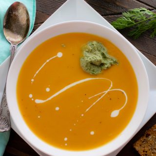 Roasted Carrot and Parsnip Soup with Carrot Greens Pesto is a tasty soup that is so easy to make! You'll love Roasted Carrot and Parsnip Soup with Carrot Greens Pesto for the rich and thick soup it is.