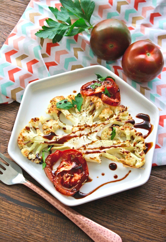 Roasted Cauliflower and Tomatoes with Balsamic Glaze is the perfect side this time of year. You'll love the flavor and how filling it is.
