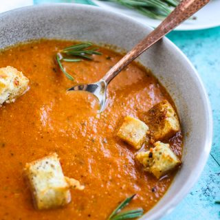 Roasted tomato and vegetable soup with gin drizzle is an ideal soup for the season. Roasted tomato and vegetable soup with gin drizzle is comforting and flavorful for a seasonal dish.