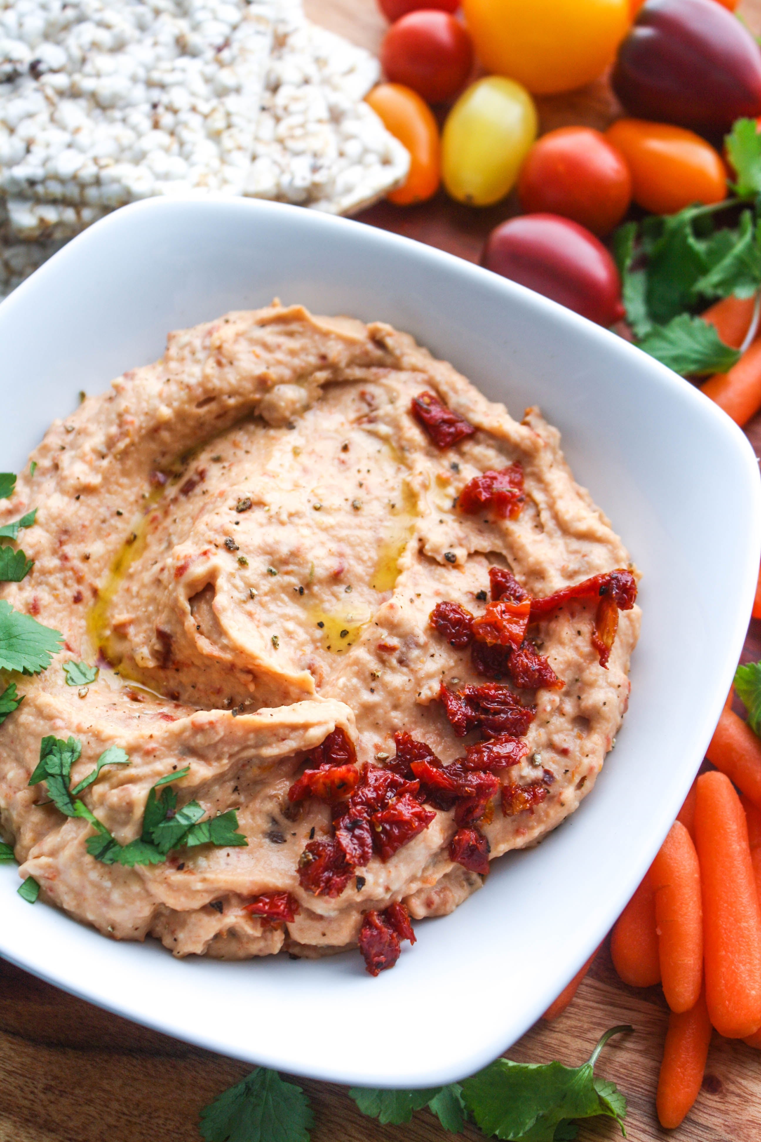 Roasted Garlic and Sun-Dried Tomato Hummus is a fabulous snacking option. You'll love this hummus with roasted garlic and sun-dried tomatoes.