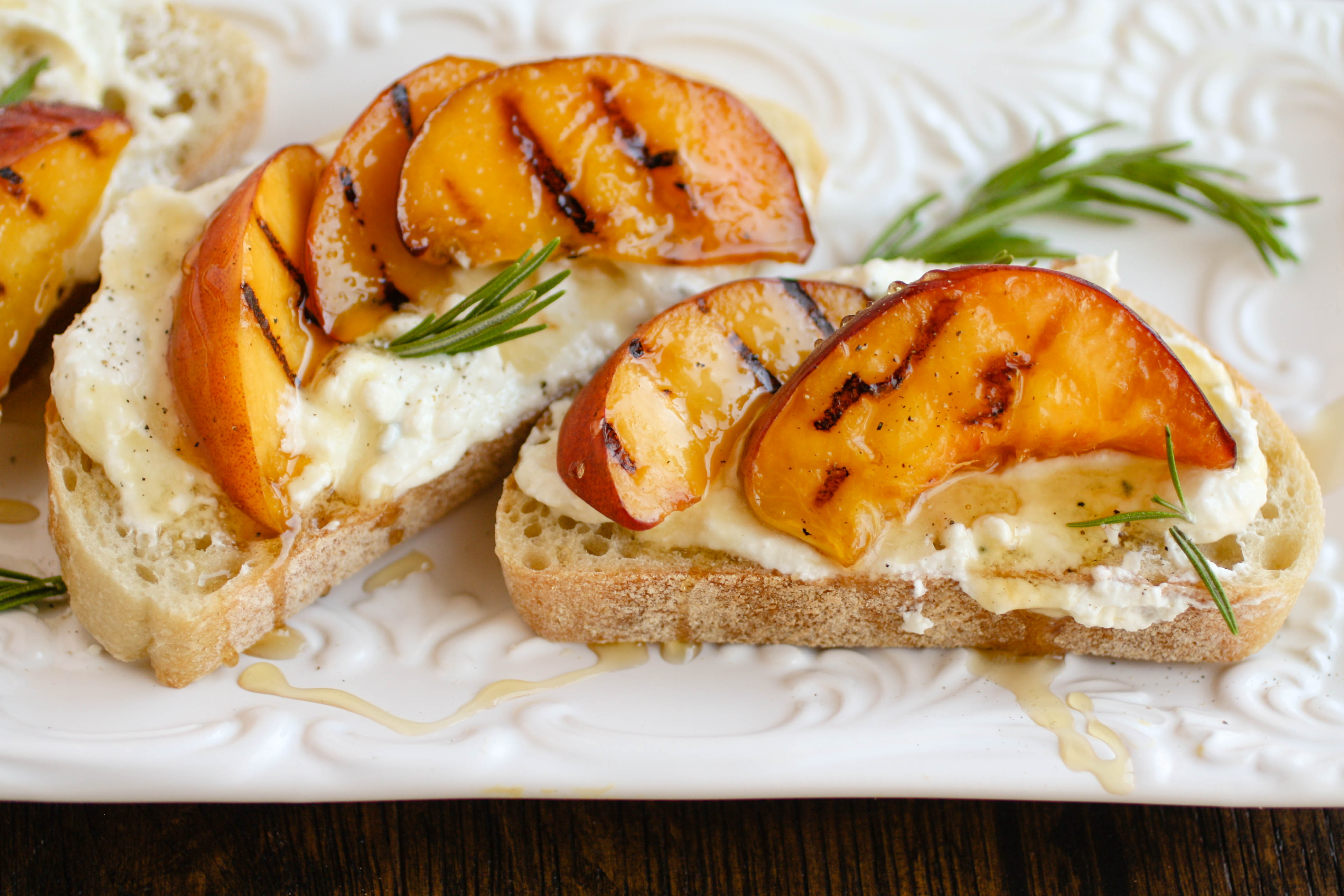 Rosemary Whipped Feta with Grilled Peaches and Honey is the cheese spread you need in your life! This makes a great appetizer for any get together.