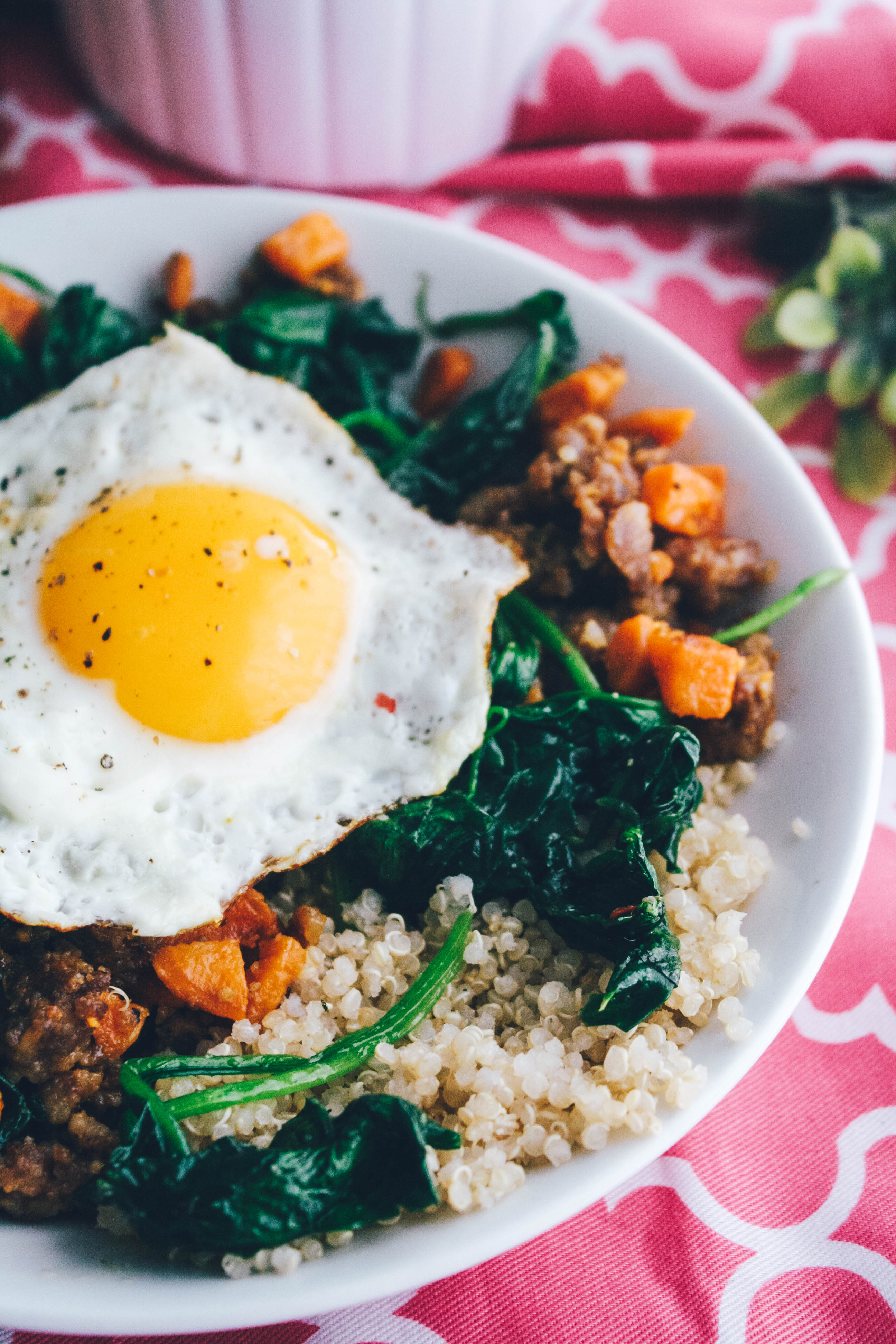 Sausage, Sweet Potato & Spinach Quinoa Bowls with Egg make a wonderful and filling meal. Sausage, Sweet Potato & Spinach Quinoa Bowls with Egg are filling and flavorful!