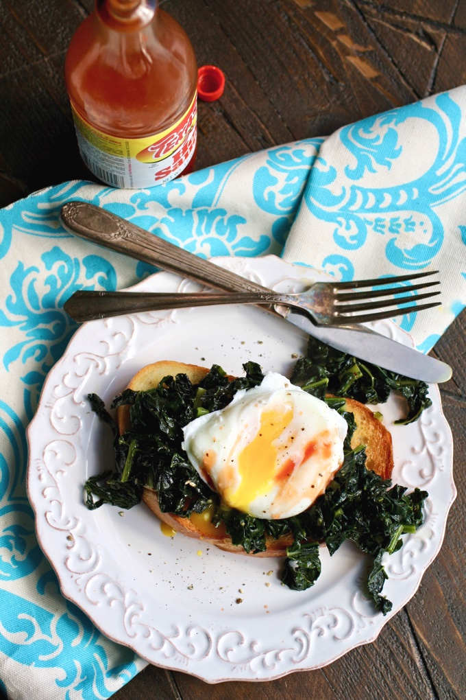 Sauteed Kale on Toast with Poached Eggs is delicious! Add a little hot sauce to make this breakfast dish even better!