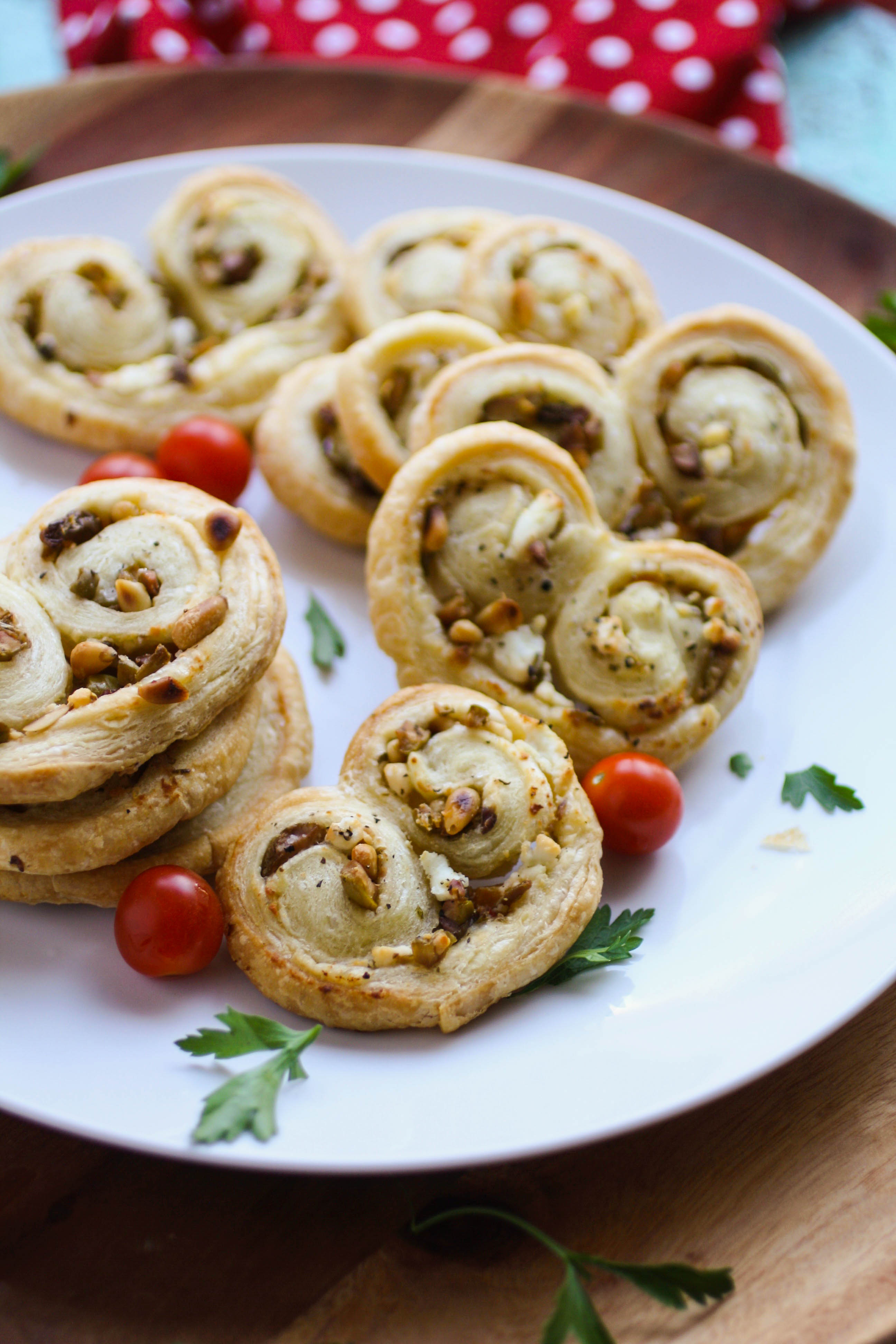 Savory Olive and Goat Cheese Palmiers are a fun treat. They're great for a get together.