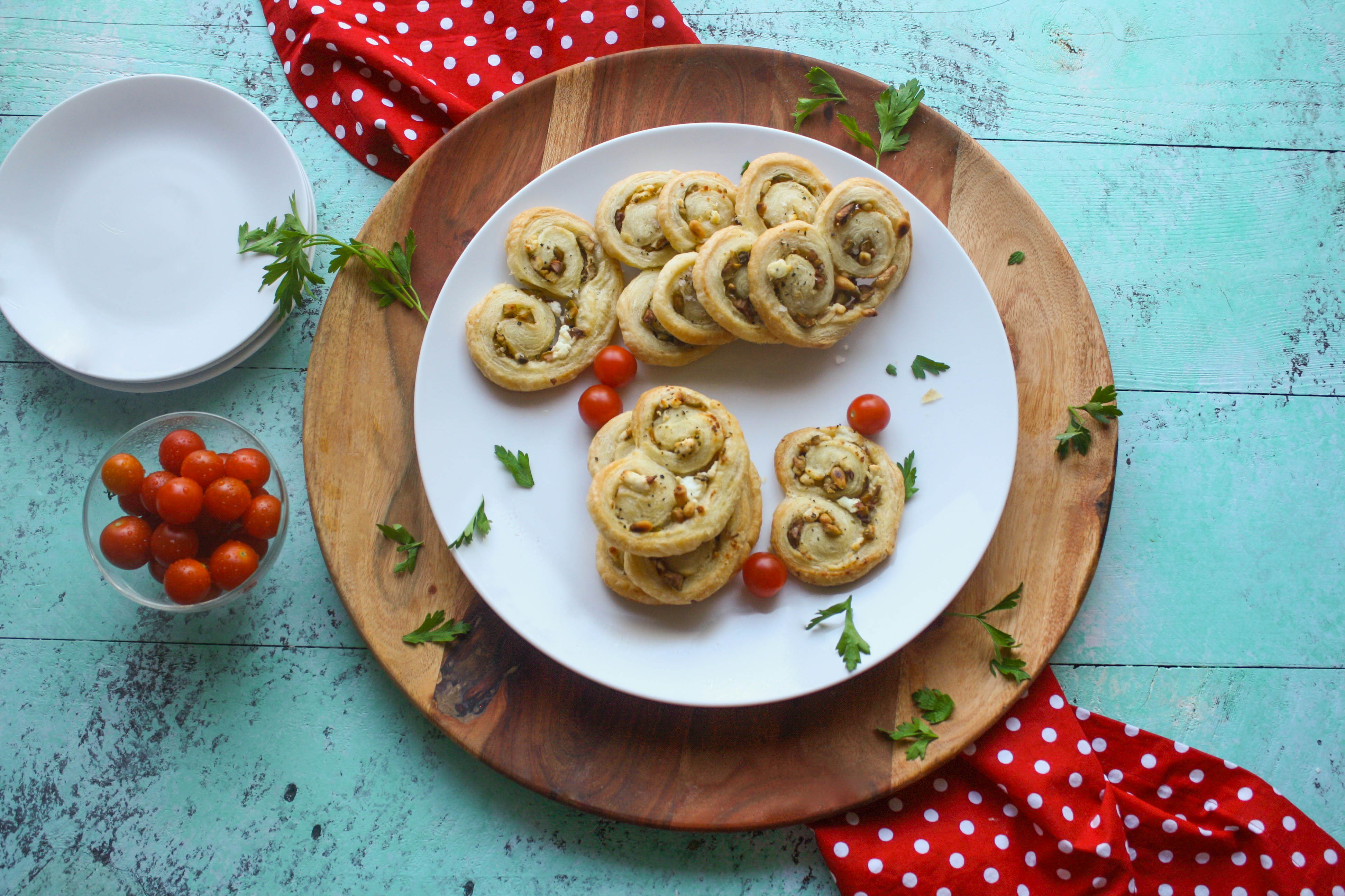 Savory Olive and Goat Cheese Palmiers are a fun snack to share. They're so easy to make, too!