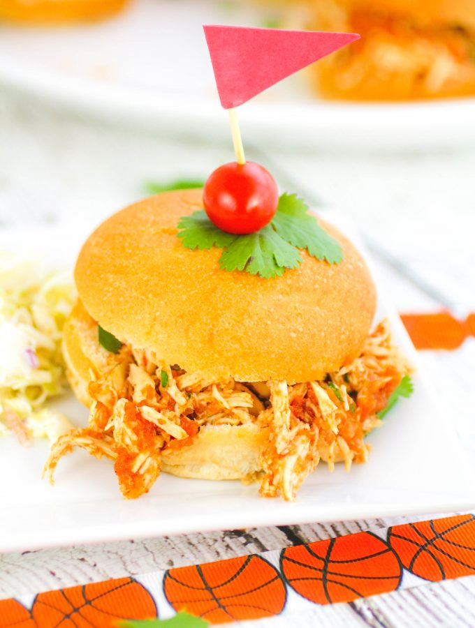 Slow Cooker Southwestern Pulled Chicken Sandwiches are perfect for parties. Make a batch of Slow Cooker Southwestern Pulled Chicken Sandwiches for the big game.