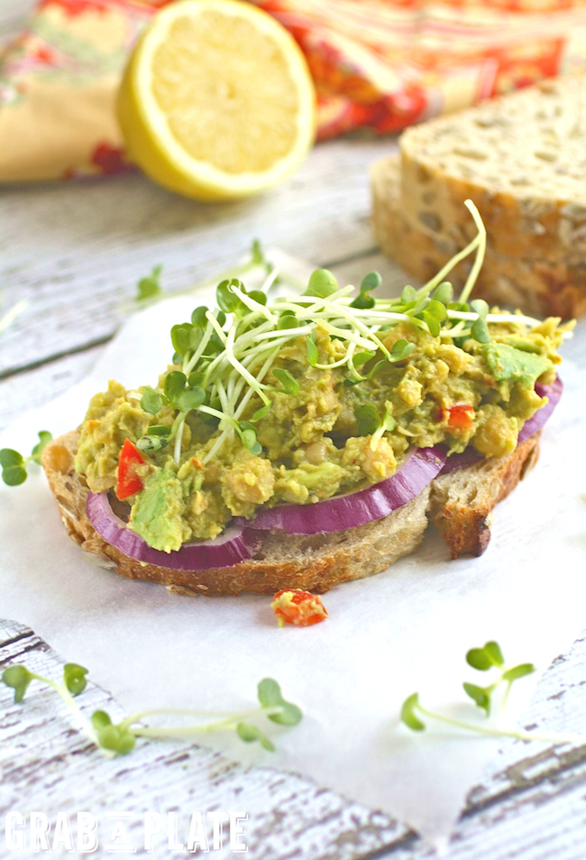 Delight in these filling and flavorful Spiced and Smashed Chickpea and Avocado Sandwiches #MeatlessMonday #vegan