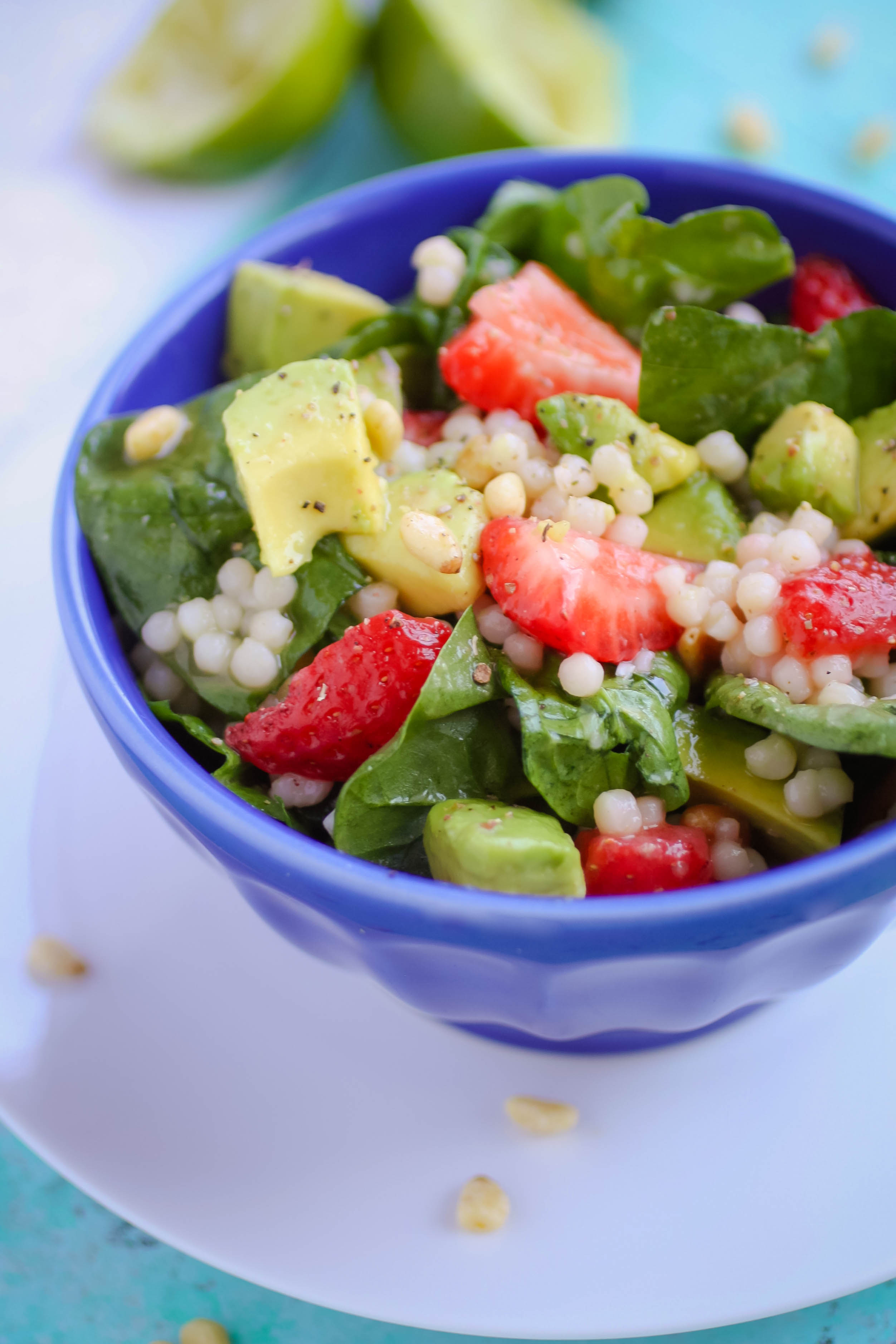 Spinach and Couscous Salad with Strawberries, Avocado & Honey-Lime Dressing is a wonderful salad for the summer. Spinach and Couscous Salad with Strawberries, Avocado & Honey-Lime Dressing is a salad you need to toss together today!