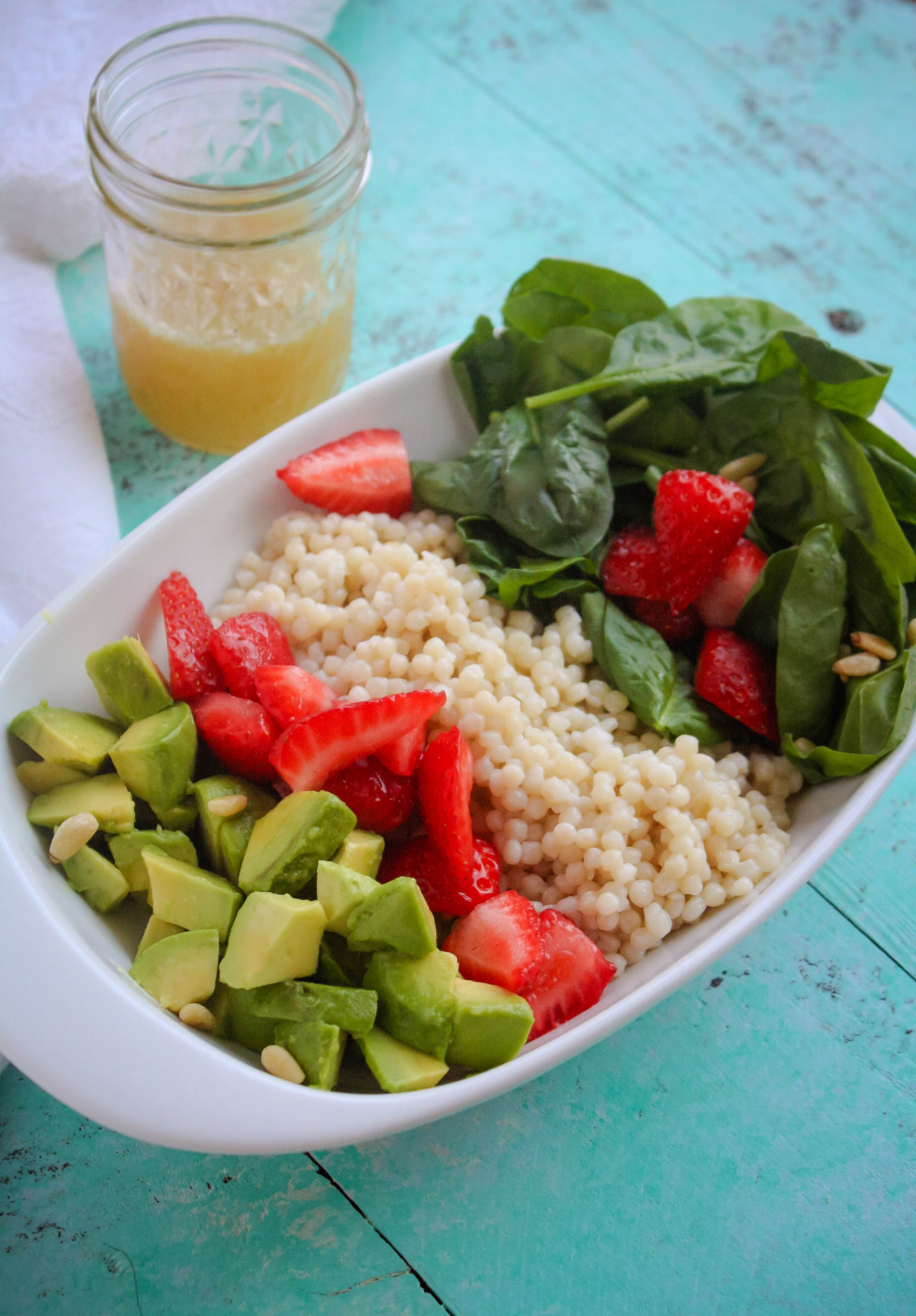 Spinach and Couscous Salad with Strawberries, Avocado & Honey-Lime Dressing is the kind of summer salad that will satisfy! Spinach and Couscous Salad with Strawberries, Avocado & Honey-Lime Dressing is a delightful summer dish.