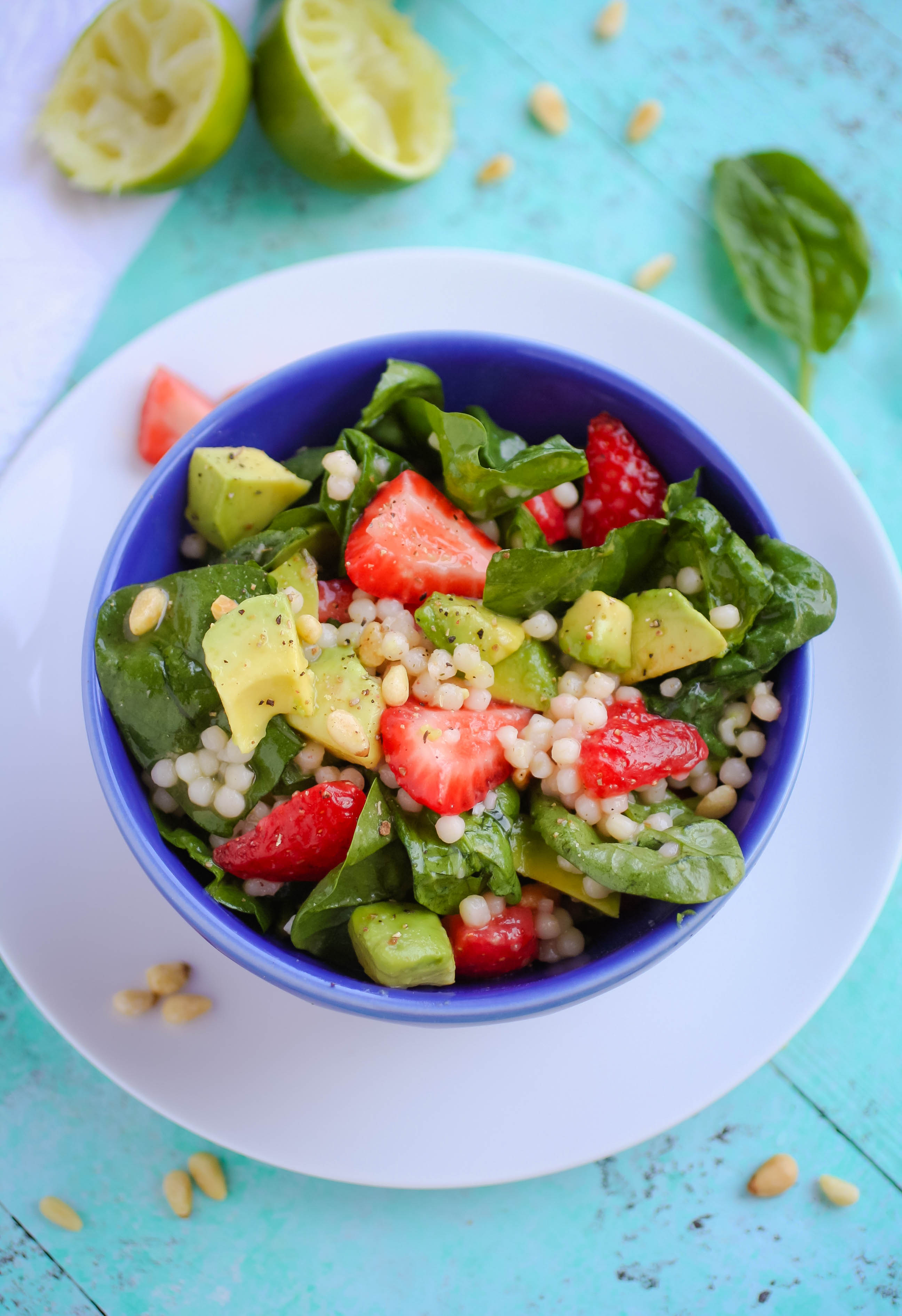 Spinach and Couscous Salad with Strawberries, Avocado & Honey-Lime Dressing is my new favorite summer salad. Spinach and Couscous Salad with Strawberries, Avocado & Honey-Lime Dressing is full of flavor and color!