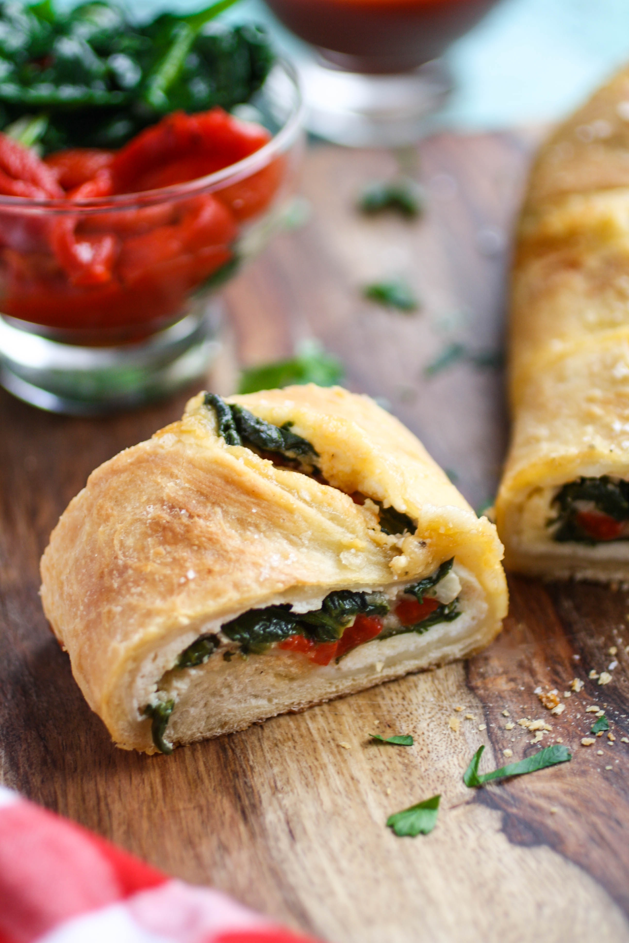 Spinach and Roasted Red Pepper Stromboli is a wonderful dish to serve any night of the week. Stromboli is like pizza, but rolled up and baked!