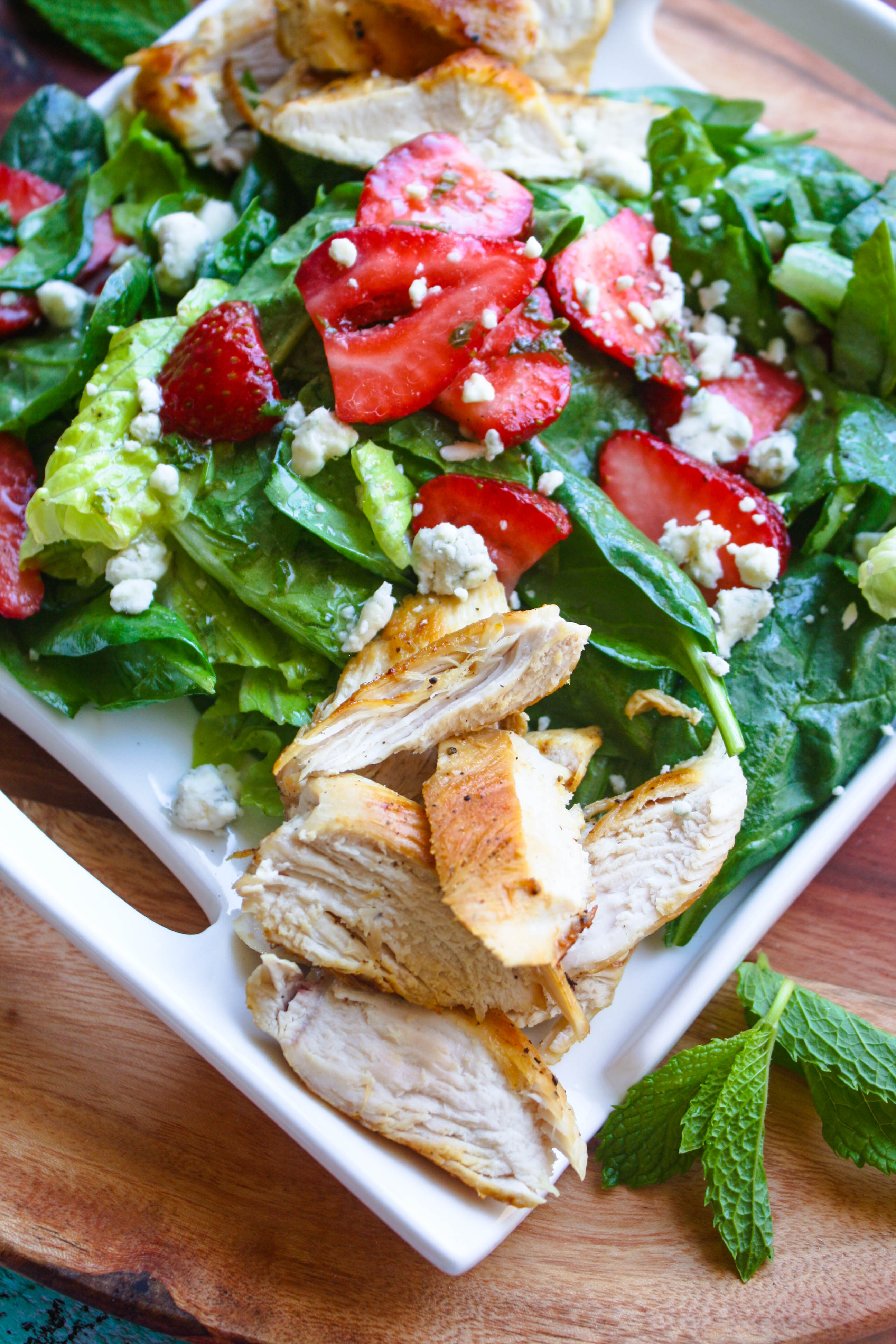 Chicken Salad with Strawberries and Honey-Lemon Mint Dressing is a sweet, satisfying meal. You'll love the flavors and colors in this easy-to-make, hearty salad.