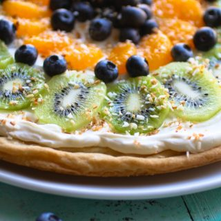 Sugar Cookie Fruit Pizza is a super-simple dessert to make! It's perfect for picnics and holidays!