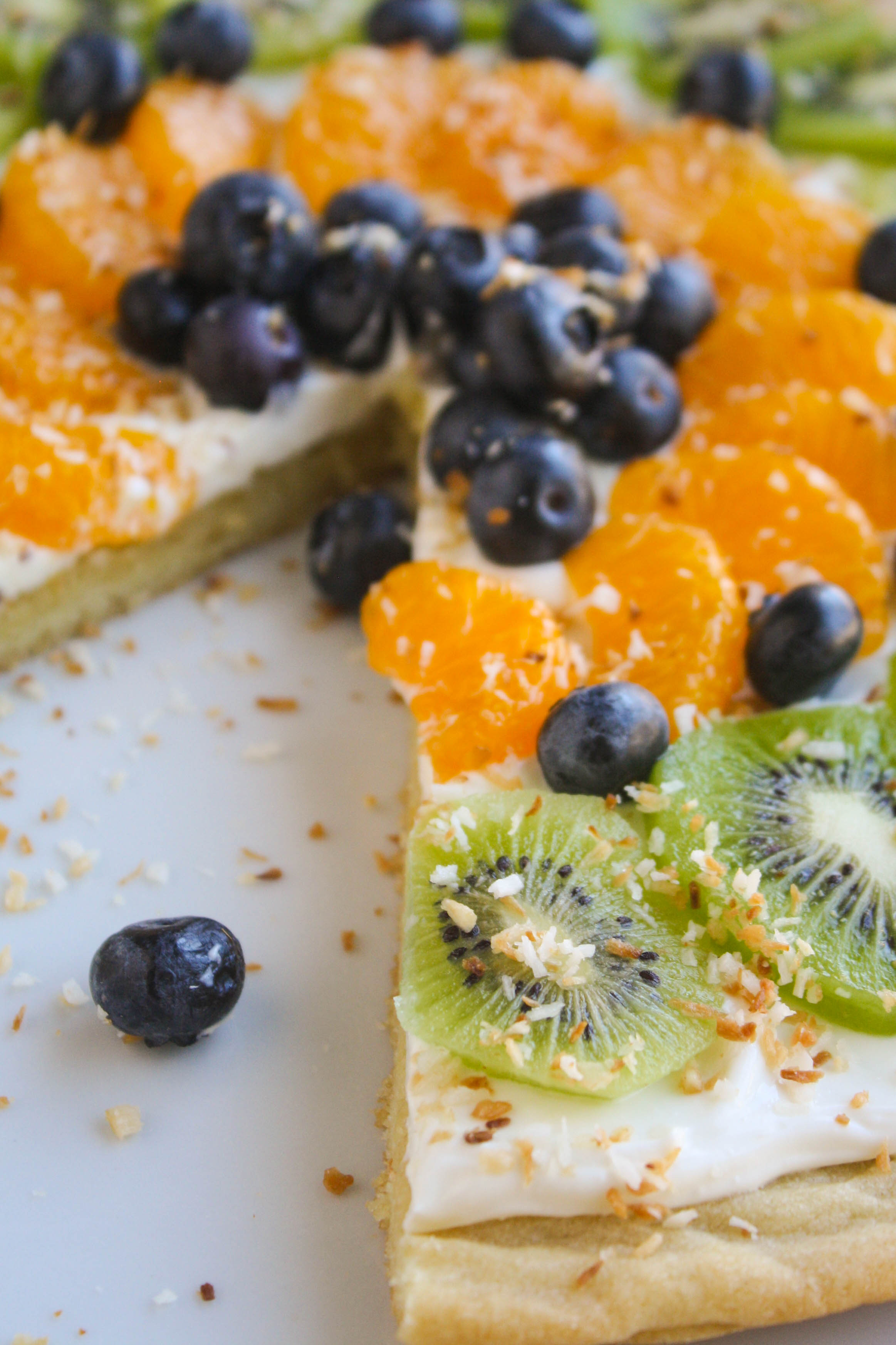 Sugar Cookie Fruit Pizza is a delicious dessert! You'll want more than one slice of this sugar-cookie-crust and fruit treat!