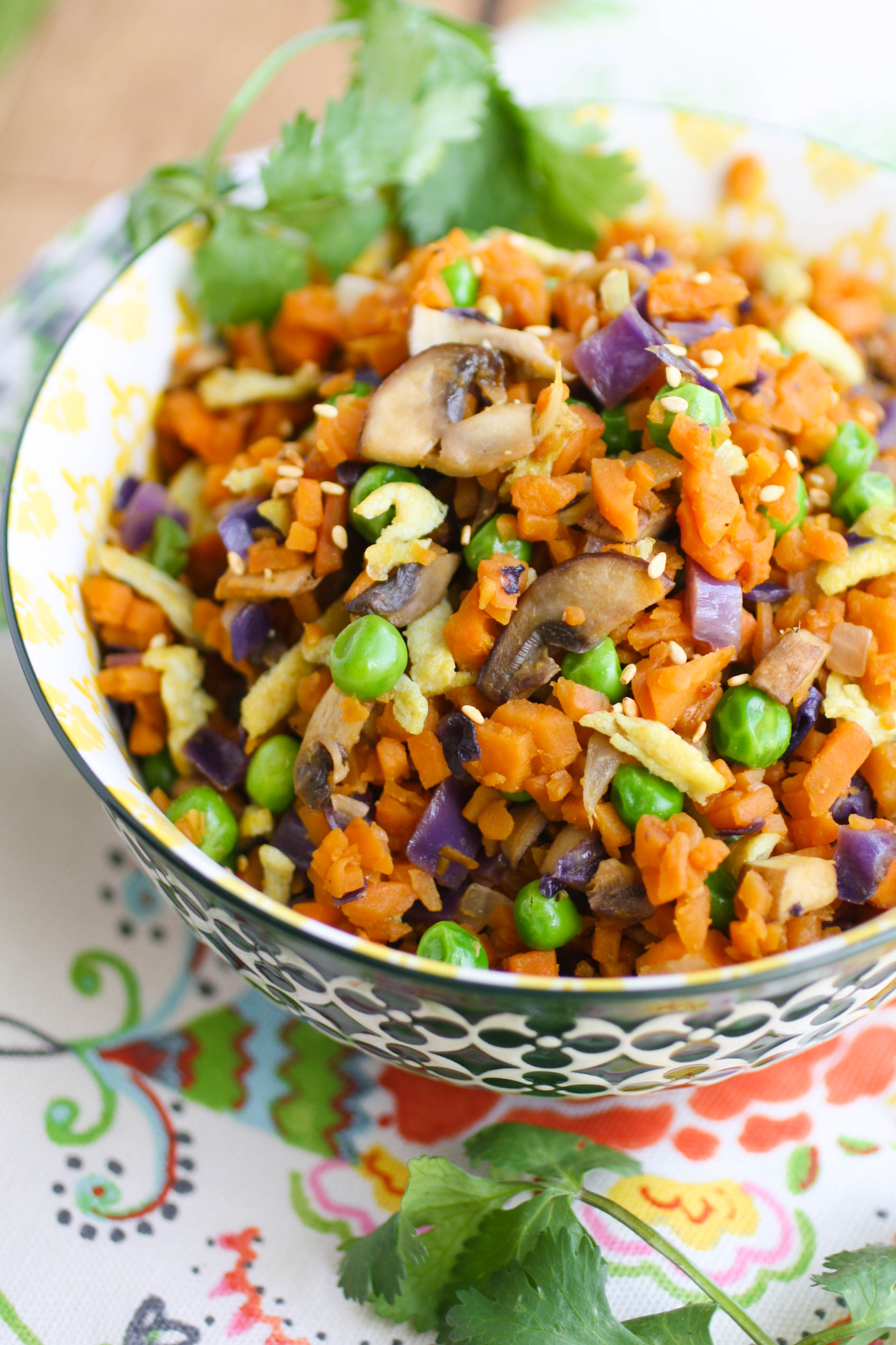 "Sweet Potato ""Fried Rice"" is a fun and colorful dish your family will love! Try it as a healthy dish to serve on a Meatless Monday, too!"