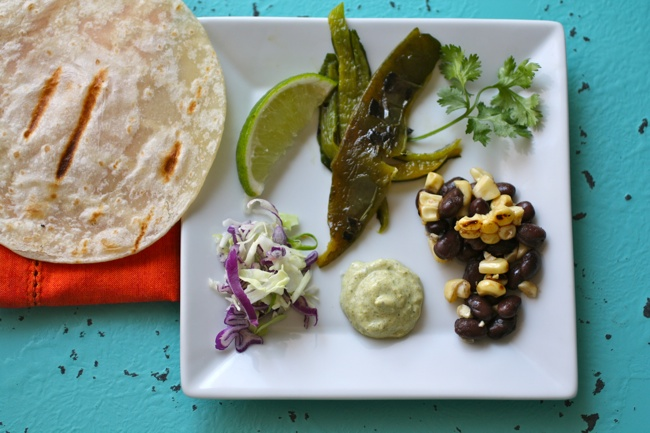 A plate of Grilled Corn, Peppers & Black Bean Tacos,Taco ingredients