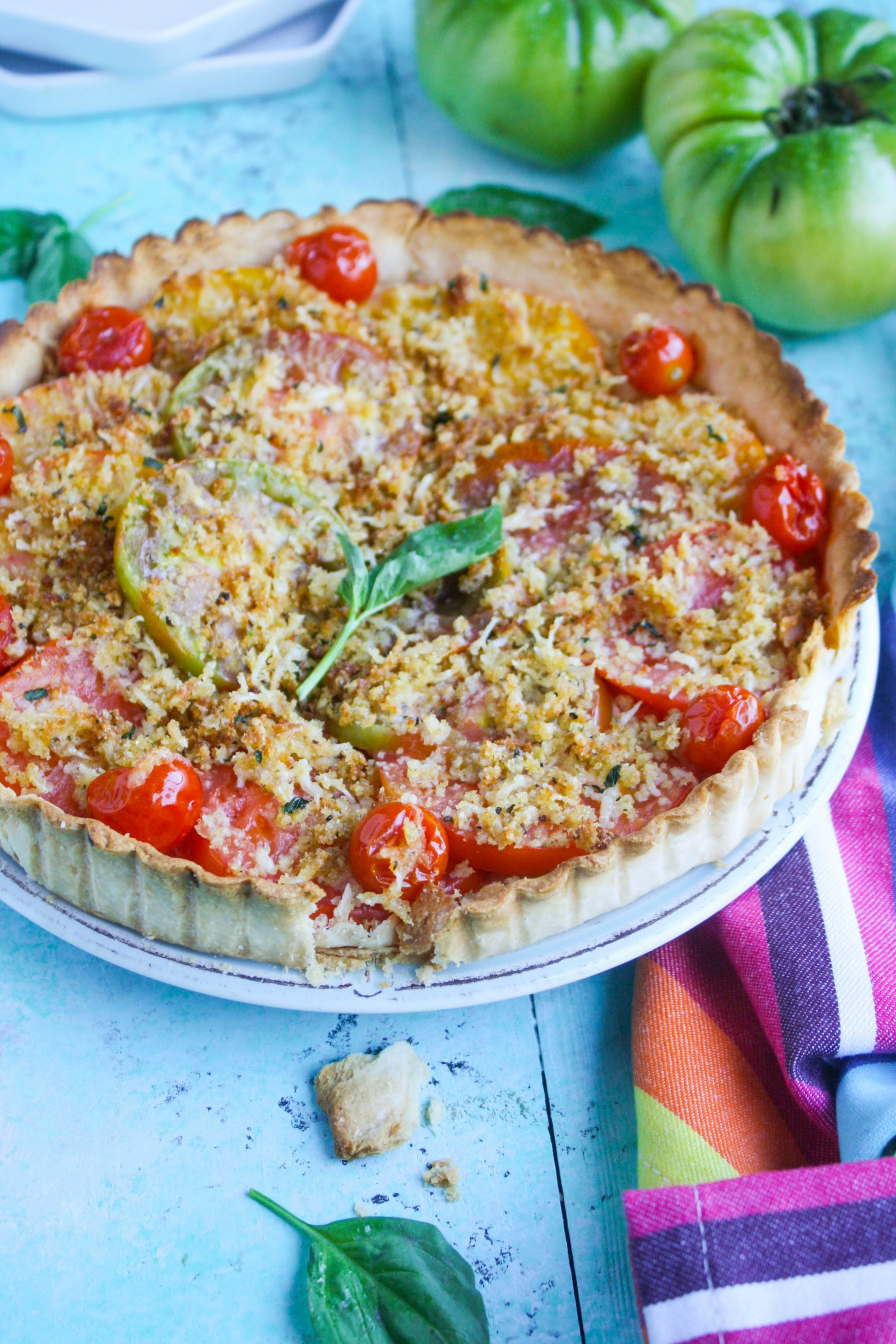 Tomato Tart with Cheesy Breadcrumbs is a wonderfully simple and flavorful dish you need to make before the summer is over! This simple tart is big on flavor.