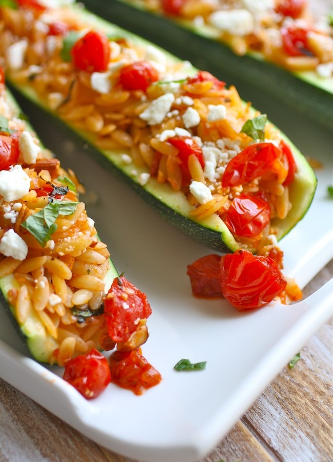 Stuffed Zucchini with Herbed Orzo, Almonds, and Fresh Tomato Sauce