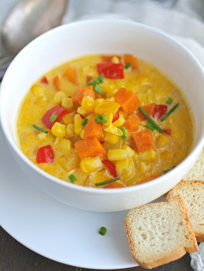 This recipe for Corn and Sweet Potato Chowder with Saffron Cream is rich, colorful, and hearty!