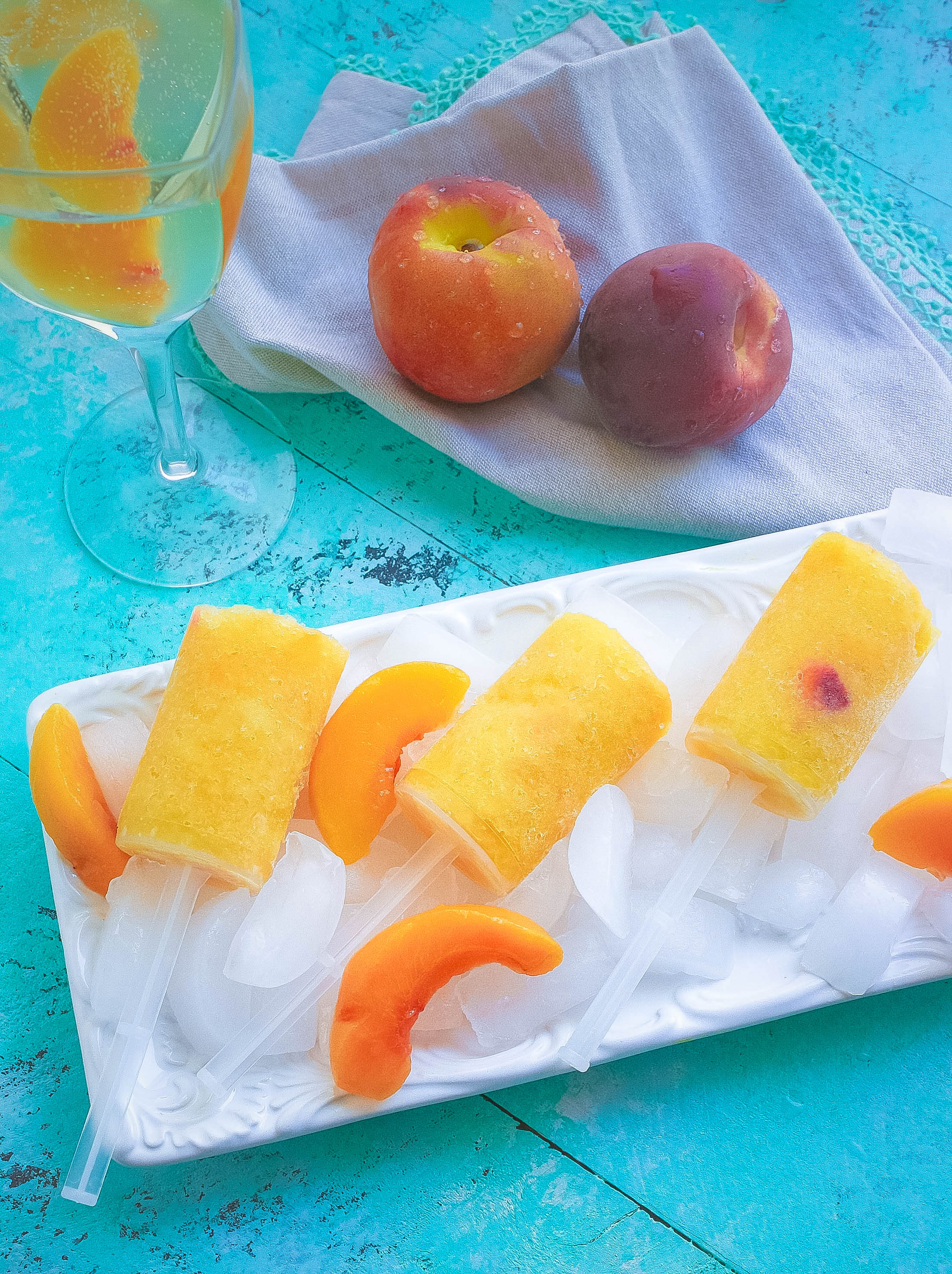Frozen Peach Bellini Push Pops are true summer fun! Frozen Peach Bellini Push Pops are a great way to chill out on a hot day.