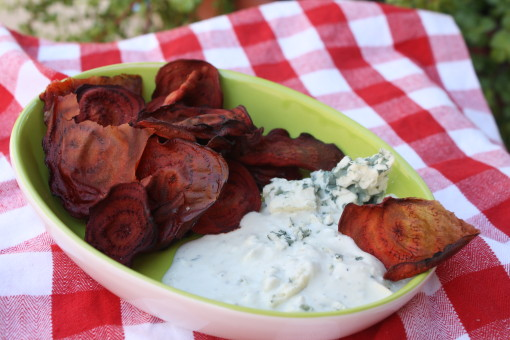 Baked beet chips served with blue cheese dip