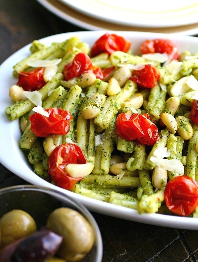 Kale Pesto Pasta with Roasted Tomatoes and White Beans is a simple, flavorful Meatless Monday (or any night of the week) meal!