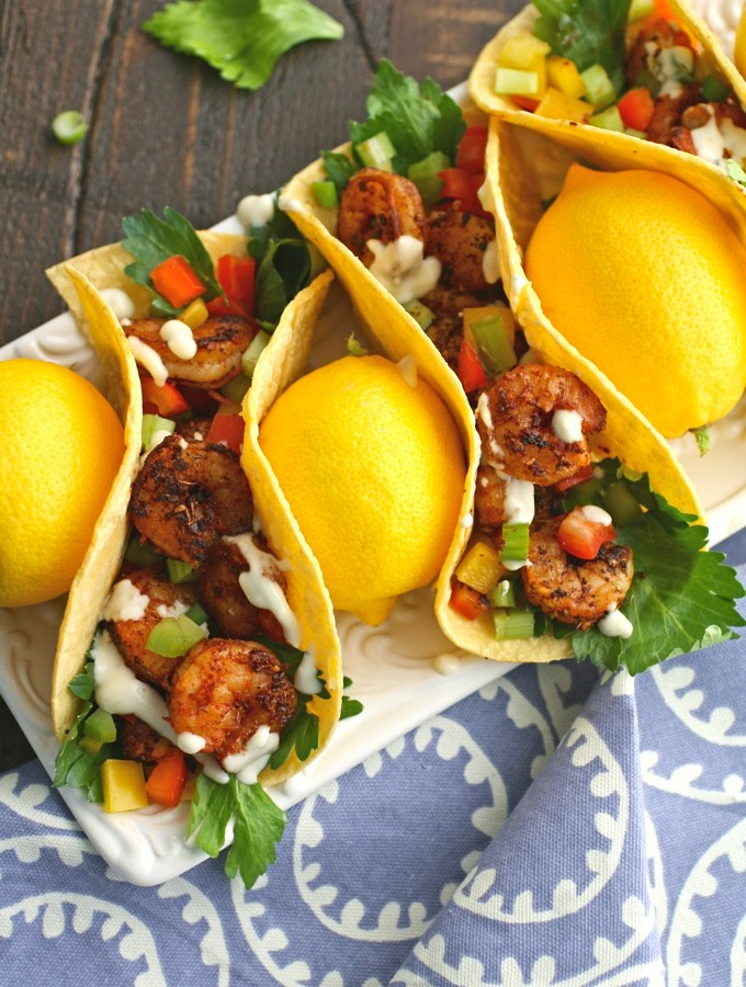 Who needs an excuse for tacos? Not me! Try these easy-to-make Blackened Shrimp Tacos with Creamy Garlic-Lemon Sauce!