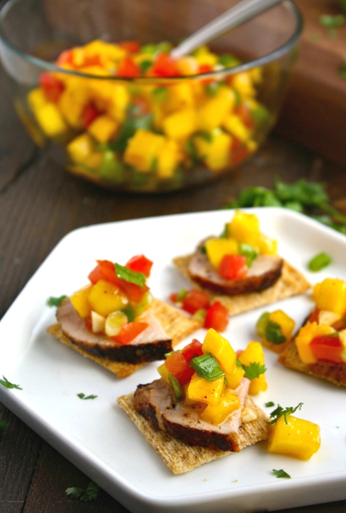 Leave the chips and salsa for another time! Try Pork Tenderloin Bites with Mango Salsa for a hearty appetizer instead!