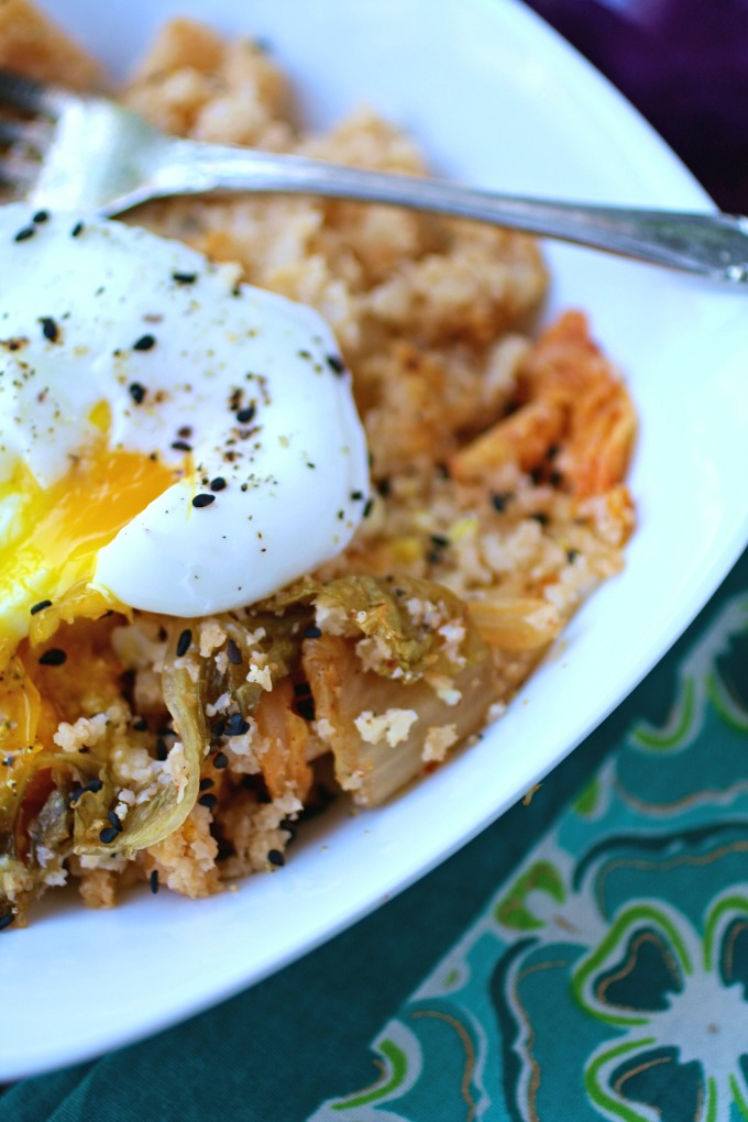 """Dig into an easy-to-make and flavorful dish like Kimchi and Cauliflower Fried """"Rice"""" with Poached Eggs!"""
