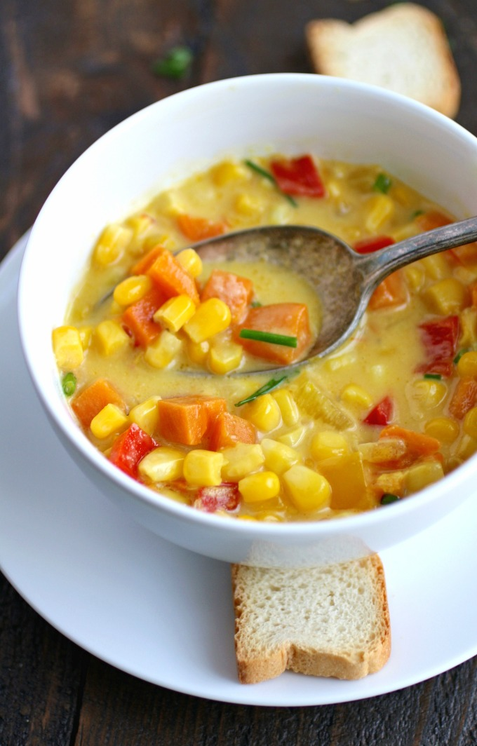 Grab a spoon and dig into Corn and Sweet Potato Chowder with Saffron Cream!